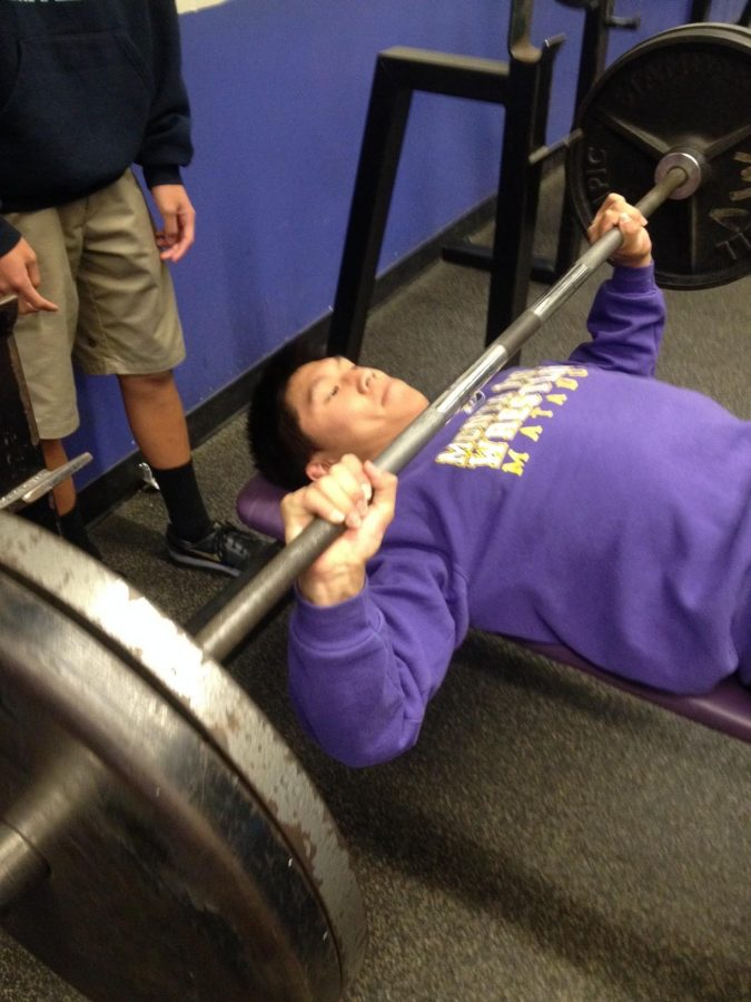 Senior co-captain Aaron Wu, a three-year wrestler and returning CCS qualifier for MVHS, prepares for the upcoming season with his teammates in the weight room. He has been training through the entire offseason with the year-round wrestling club. Photo by Alaina Lui.