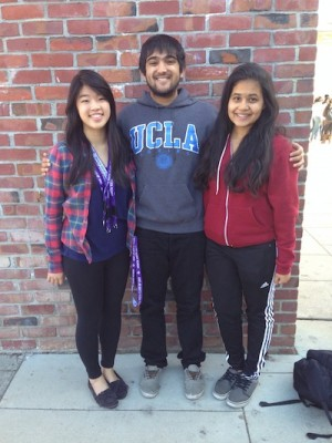 Juniors Carmelia Muljadi, Neil Gupta and Monique Miranda (left to right) stand in front of the A building. All three are officers of the newly-formed Microfinance Club, which aims to help entrepreneurs in third-world countries establish businesses. Photo by Varsha Venkat.