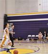 Basketball player takes a tumble