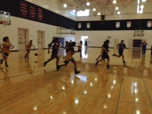 The varsity girls basketball team practices in the field house on Nov. 27. The first home scrimmage was held on Dec. 2 in the main gym. Photo by Lydia Seo.