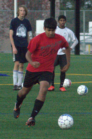 Junior Anurag Kelkar prepares to shoot a goal during a practice on Thursday, Nov. 21. This is Kelkar's first season on varsity after two years playing on JV. Photo by Rhonda Mak.