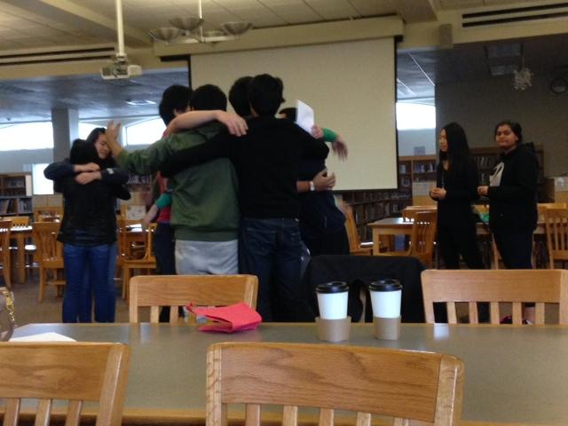 Members+hug+after+playing+%22cross+the+line.%22+Photo+by+Elia+Chen.
