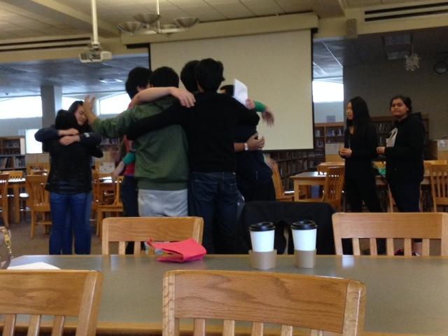 Members hug after playing