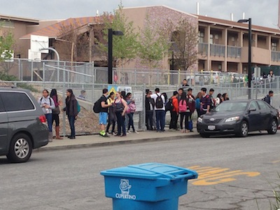 Students exit the MVHS campus around noon and wait on Fort Baker Dr. for their rides home. Principal April Scott made an announcement over the school's PA system about 30 minutes into fifth period to inform students that school would be out of session for the remainder of the day. Photo by Varsha Venkat.