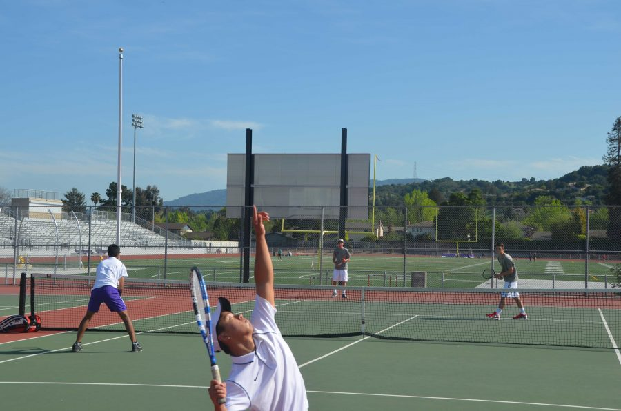 Senior Jonathan Yao serves against Sacred Heart on April 8th. While Yao's doubles team with Vinay Reddy would go on to lose the set and the match, Monta Vista managed to seize the series 5-2. Photo by Pranav Parthasarathy
