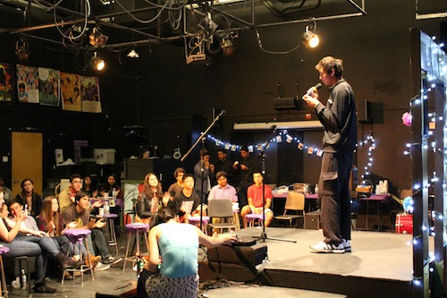 Sophomore Evan Zhang sings at the La Pluma Coffeehouse. The event featured a variety of acts including singing, dancing and role play. Photo by Varsha Venkat.