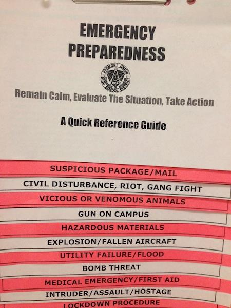 There is a packet of emergency preparation guidelines in each classroom. Although measures like these are common in schools, some students believe that more precautions should be taken to increase safety. Photo by Varsha Venkat.