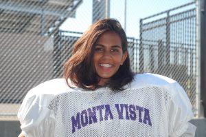 Sophomore girl tackles football and cheer
