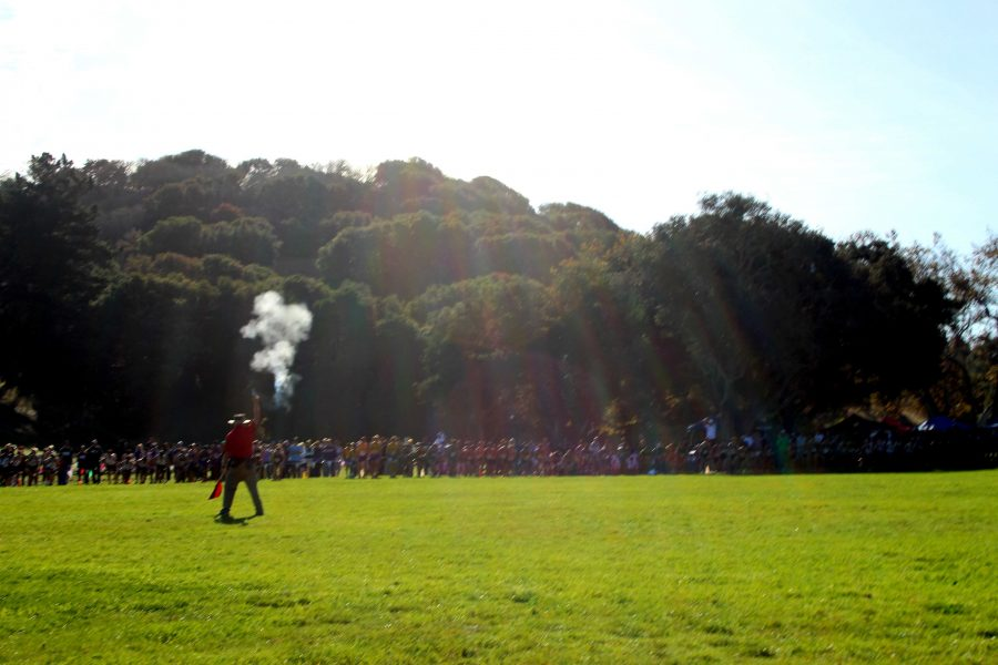 In the morning at Toro Park on Nov. 15, the gun goes off and the varsity boys launches off of the starting line. Varsity boys ran first at 10 a.m., followed by the varsity girls at 10:30 a.m. Photo by Sharon Tung.
