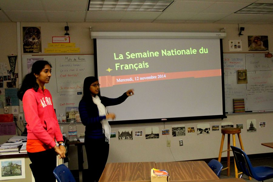 During lunch in room B109, senior Rhea Choudhury introduces the Jeopardy game she and other officers of the club made. She then splits the club members into two groups to play the game. Photo by Sharon Tung.