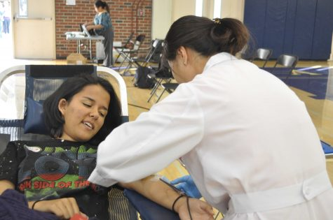 Senior Saba Naqvi donates a pint of blood for the first time.