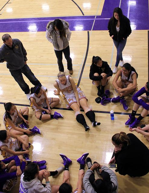 Girls basketball sits in the far corner of the gym to talk after the game on Feb. 11. MVHS defeated Fremont High School 43-23 after securing a wide lead early on.