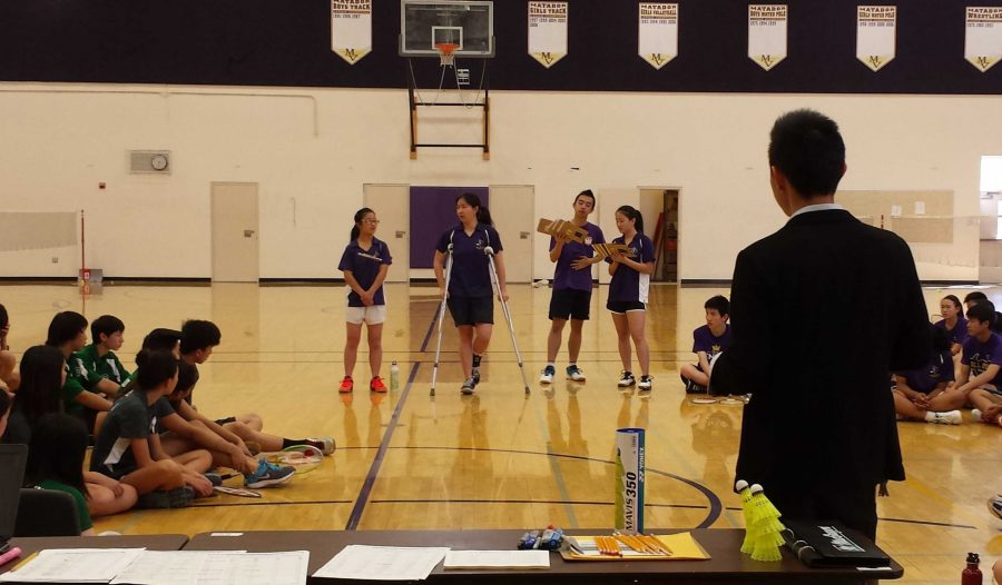 Badminton+coach+Eric+Liu+watches+as+Matadors+explain+the+rules+of+the+Field+House+to+both+teams+on+March+19.+The+short+introduction+is+customary+to+most+badminton+games.+Photo+by+Brandon+Chin.