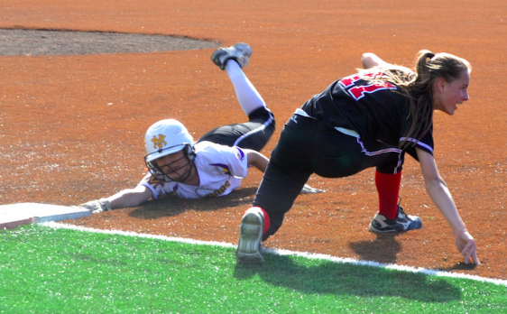 Junior Monica McCarthy slides on to first base on March 11. The Matadors defeated Aragon High School 11-6 after scoring five runs in the first inning.