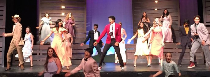 """The senior class of Bomont High holds a dance party to celebrate dance and the freedom of forgetting, or being on loose feet. """"Footloose"""" exhibited poignant, realistic portrayals of family and town relationships, with the addition of witty humor. Photo by Caitlyn Tjong."""