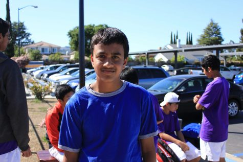Freshman Rohan Jain meets with his fellow teammates at the entrance to the tennis courts on March 27. Jain is one of the seven freshman to make it on the team this year. Photo by Brian Fan.