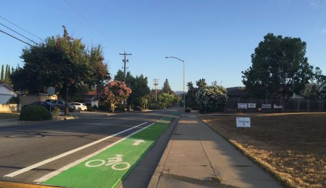 The newly painted bike lane stretches across Bubb Road in front of Kennedy Middle School. A multitude of students bike across this lane daily to get to and from school. (Photo by Elizabeth Han.)
