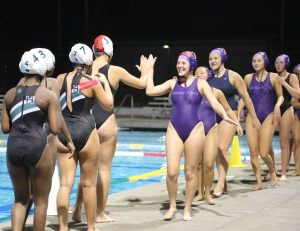 Girls Water Polo wins against HHS in the team's first home game