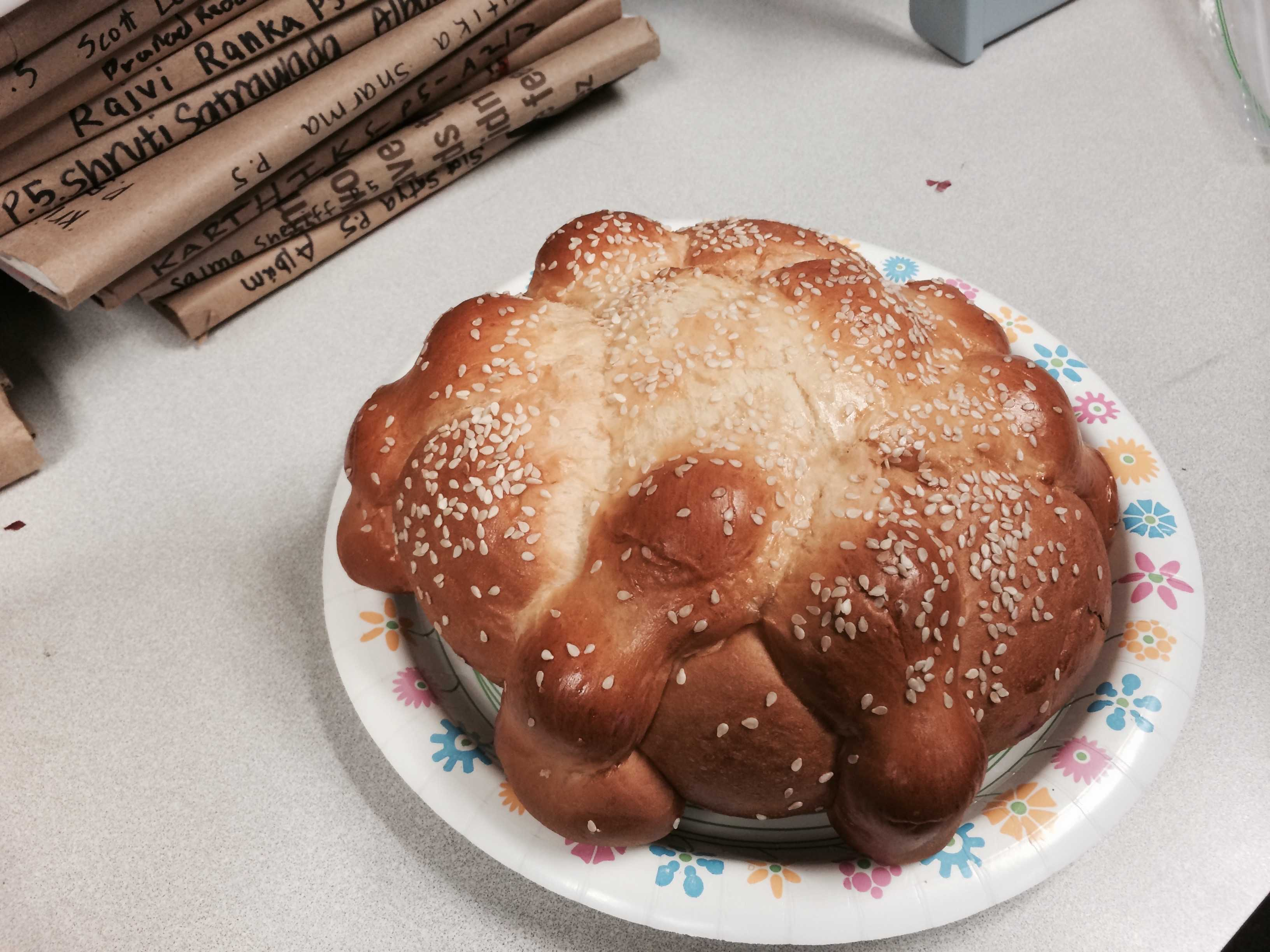 Pan de Muertos is a sweet bread eaten on special occasion in Latin America. Spanish Honor Society students celebrated Dia de los Muertos with this bread. Photo by Aditya Krishnan.