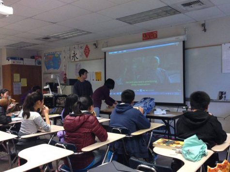 Members of CHS watch the screen attentively as officer and junior Nathan Wong and Chinese teacher Kathy Wang make final adjustments to the movie projector. The film gave a glimpse into what life and society were like in ancient China. Photo taken by Sneha Gaur