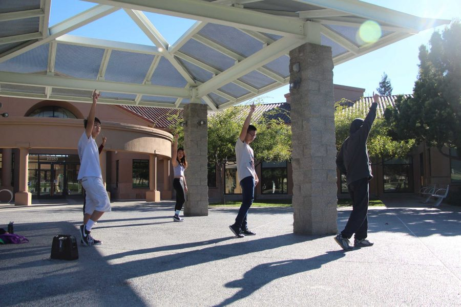 On Nov. 11, club members who were performing in the Winter Showcase meet in front of the Quilan Center in Memorial Park to go over their routine. The club members practiced frequently leading up to the Winter Showcase. Photo by Sharon Tung.