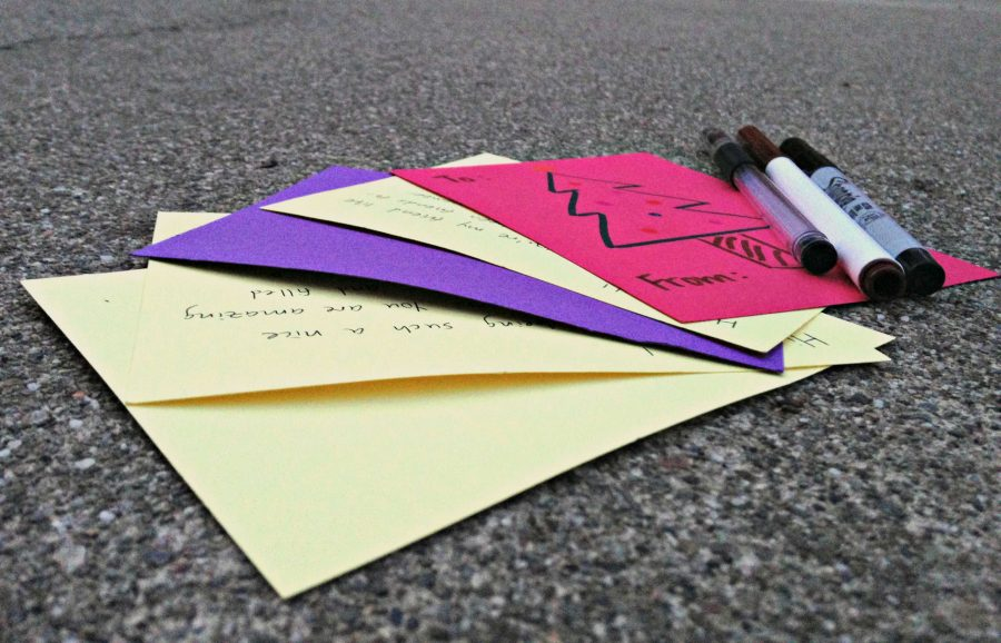 Students wrote thoughtful messages on the brightly colored cards provided for them in the rally court. The cards were dropped off into a box where they would be distributed later in the week. Photo by Jennie Chen.