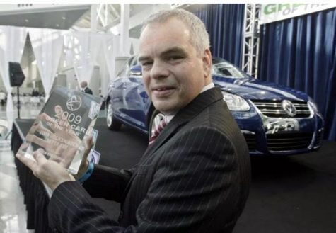 Steven Jacoby, president of Volkswagen in 2009, holds the Green Car of the Year Award. Volkswagen, along with 20 billion dollars in damages, now needs to return the eco-friendly awards it won in the past. Source: Ric Francis — AP