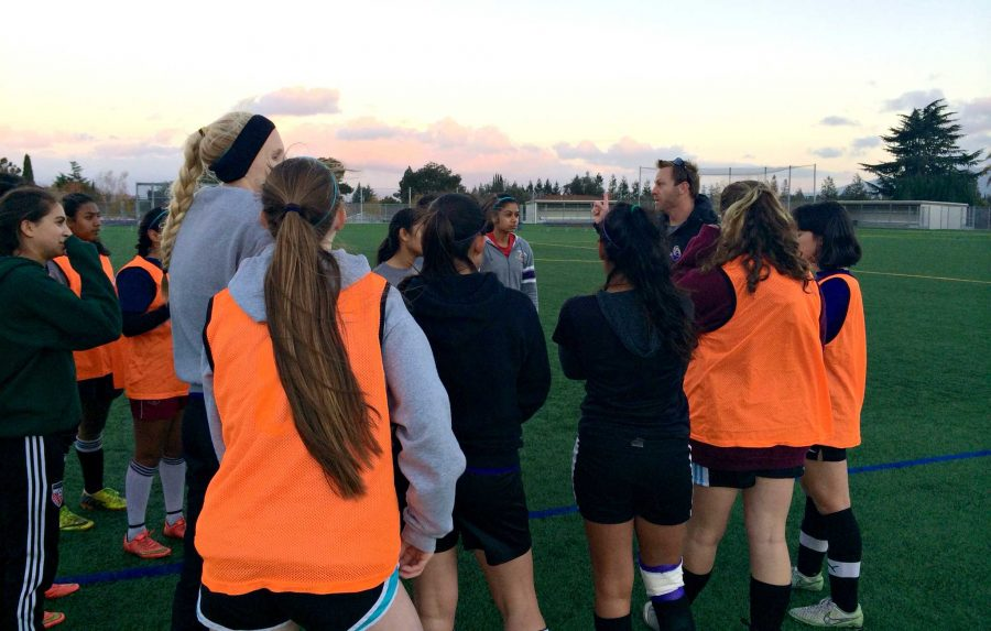 During a scrimmage on Nov. 24, the team huddles up to discuss a potential game tactic. Coach DJ Driscoll had the girls work together on better formations so they would be ready for any situation during a game. Photo by Akshara Majjiga