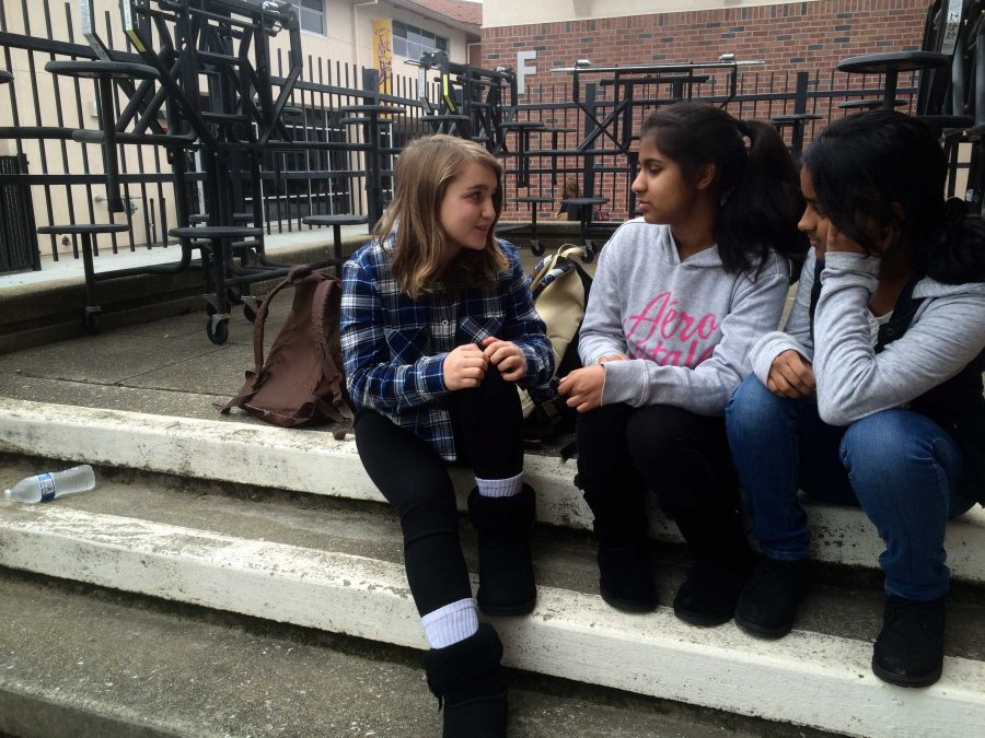 Left to right: Freshmen Elizabeth Giterman, Sarvagnya Chodavarapu and Sadhana Indukuri sit together at brunch on Jan. 11, facing the bus circle. The three have sat here all year, and spend their lunches on these steps as well.