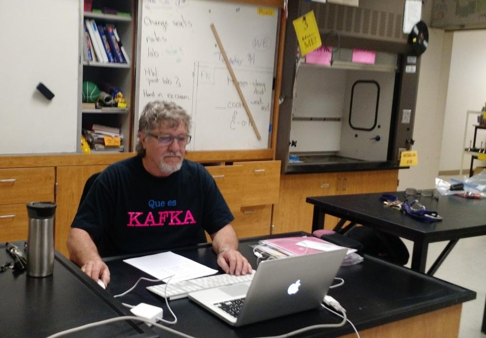 Chemistry teacher Mike McCrystal works on scheduling and grading during class. His shirt references Franz Kafka, a famous Jewish author who specialized in grimmer tales that explored human nature and life in general.