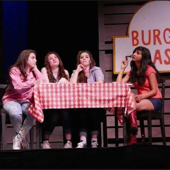Seniors Fay Neil, Ally Tsvinev, Emaan Khan and junior Christina Schuler imagine their dream guy as characters in the popular production, Footloose. They are about to sing the song I Need a Hero.  Photo used with permission of Emaan Khan