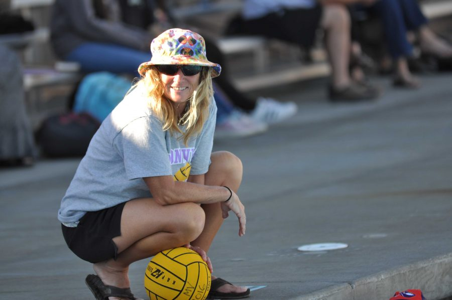 Both sides of the pool: Girls water polo coach balances the responsibility of coaching two teams at once