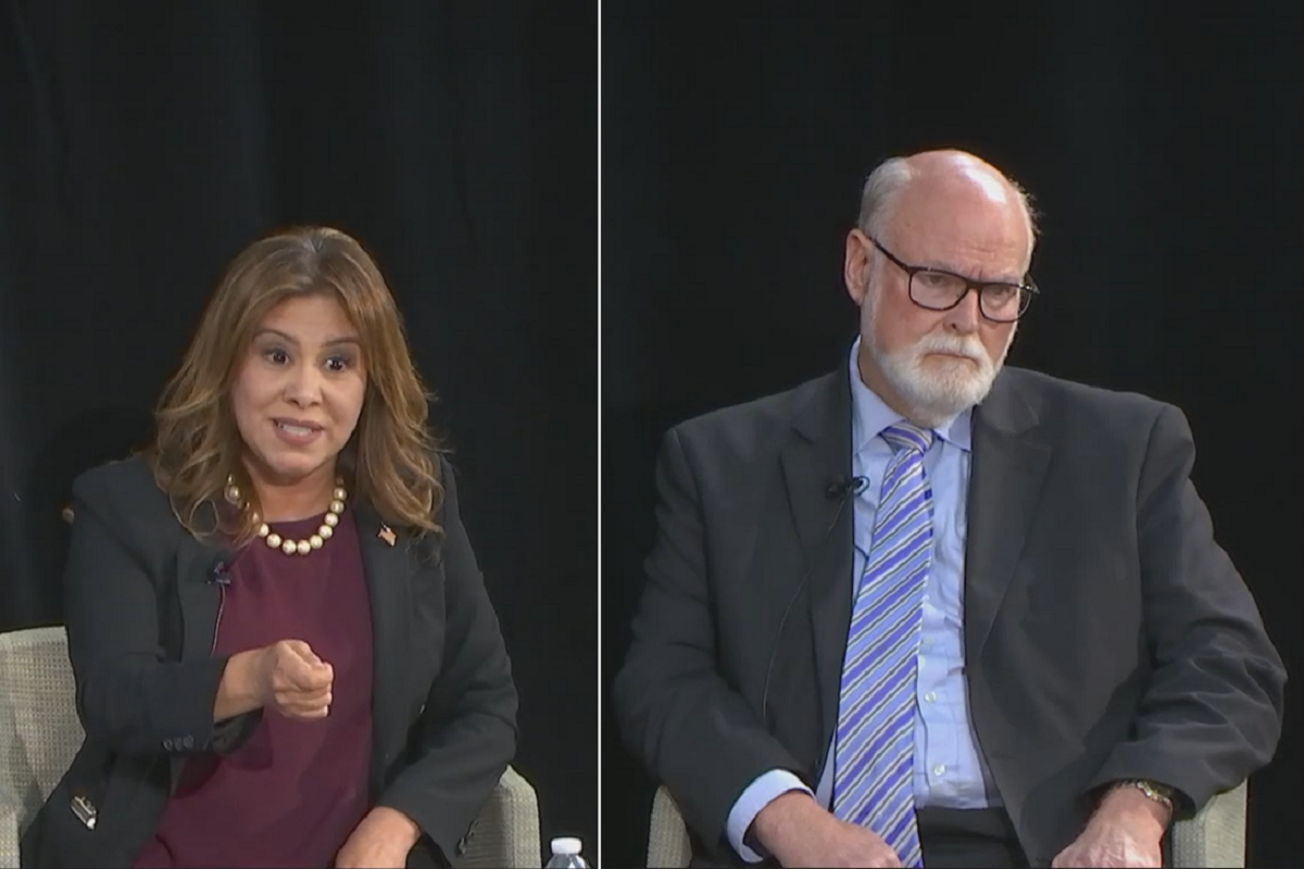 Assemblywoman Nora Campos (left) attacks State Senator Jim Beall (right) after being questioned about her oil company supporters.