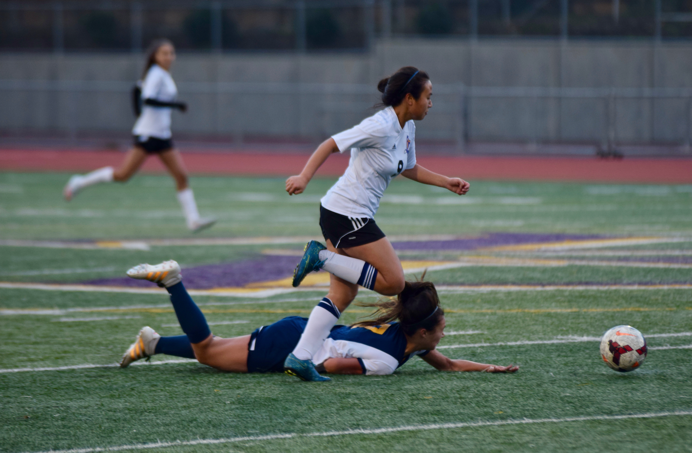 Freshman Jamie Chan dribbles past a defender in a league game against Milpitas HS.