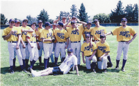 Varsity baseball coach JC Beeson poses for a goofy picture with his former MVHS baseball team.