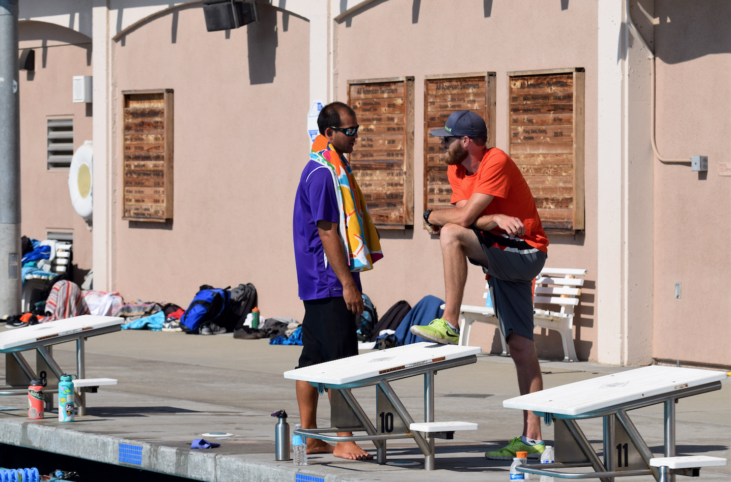 Love (left) has a brief discussion with Jarvis (right) during a water polo practice after school. Communication between the two new coaches is necessary to keep the program running smoothly.
