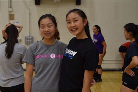 Freshmen Sammi Dunn (left) and Jackie Cai (right). Two new members of the MVHS girls volleyball team posed together before warm ups. Photo by Maggie McCormick.