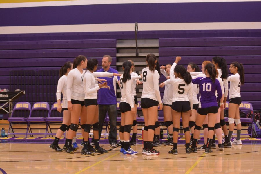 MVHS puts their hands in as they celebrate their win against Saratoga.