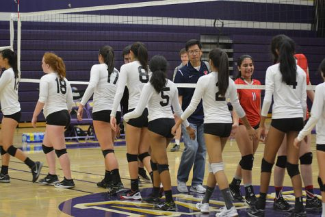 MVHS high fives Saratoga HS after the game after celebrating their victory.