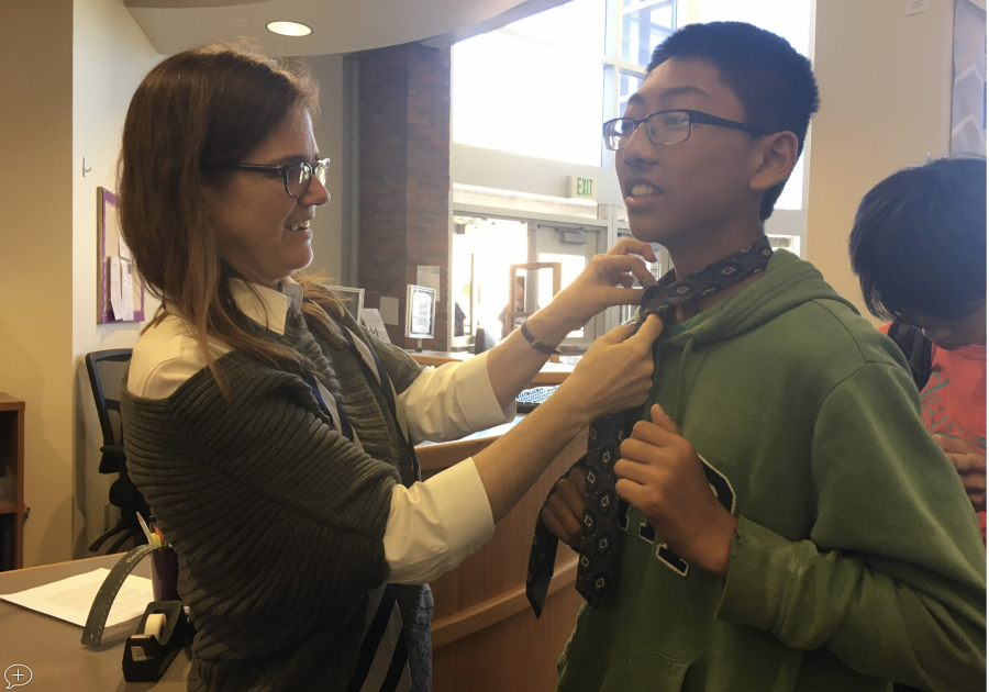 Library staff holds a tie tying tutorial