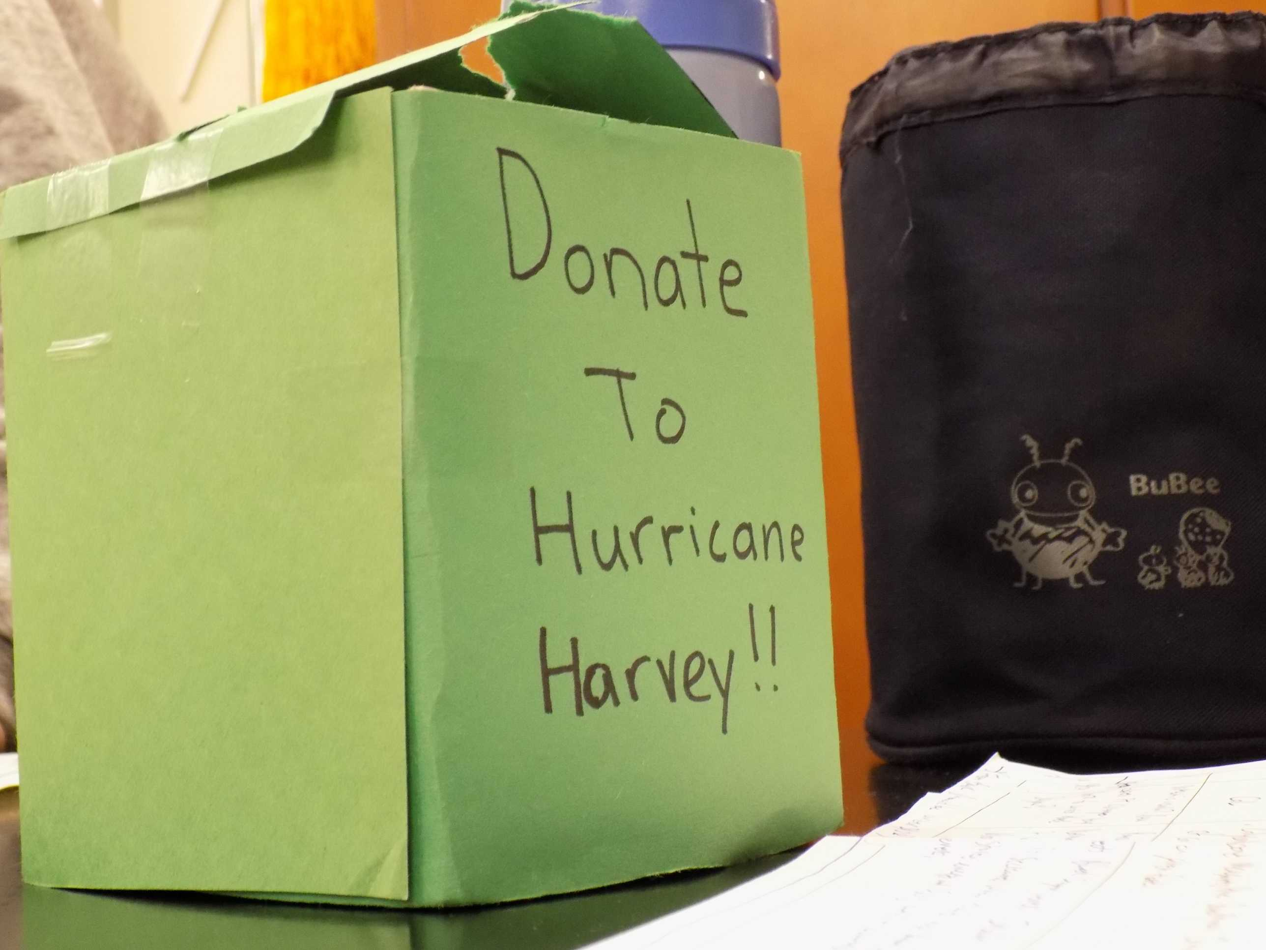 A green hurricane relief efforts donation box, made by MVHS Red Cross club members. Photo by Sara Young