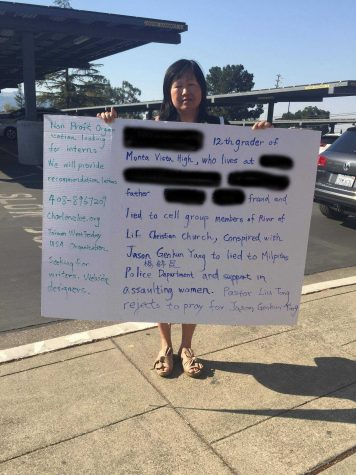 Woman with poster makes accusations against student's father