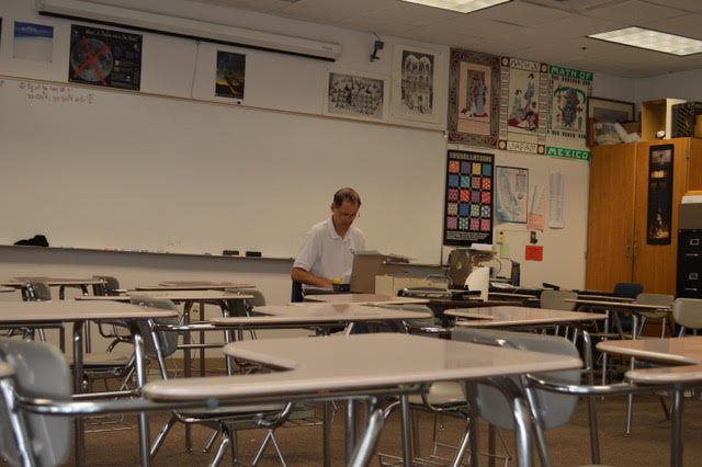 Jennings is working in his now-empty seventh period class. Photo by Rajas Habbu.