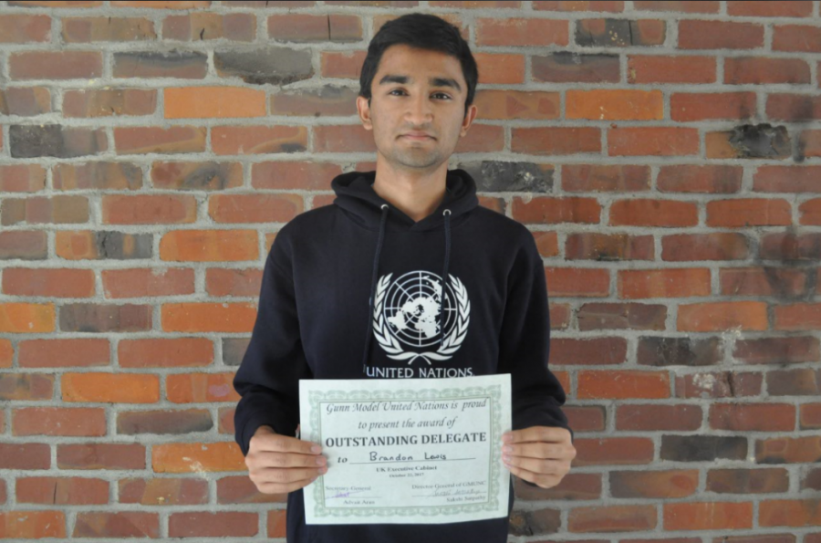 Chandramouly+stands+with+his+award.+At+the+MUN+conference+at+Gunn+HS+Chandramouly+received+an+outstanding+delegate+award.+Photo+by+Maggie+McCormick.+