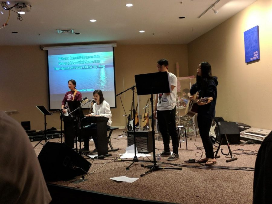 Members from different Christian clubs across FUHSD sing together on stage. They gathered for the UIC event which took place last Saturday. Photo by Bill Cheng