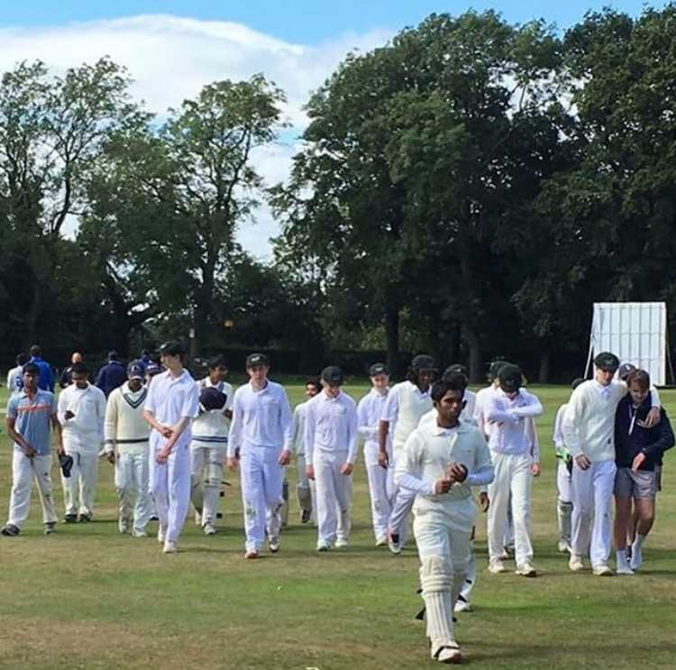 CCA players walk back to the sidelines after losing to Australia in a match. The match was this past summer in England. Photo used with permission of Sudhit Rao.