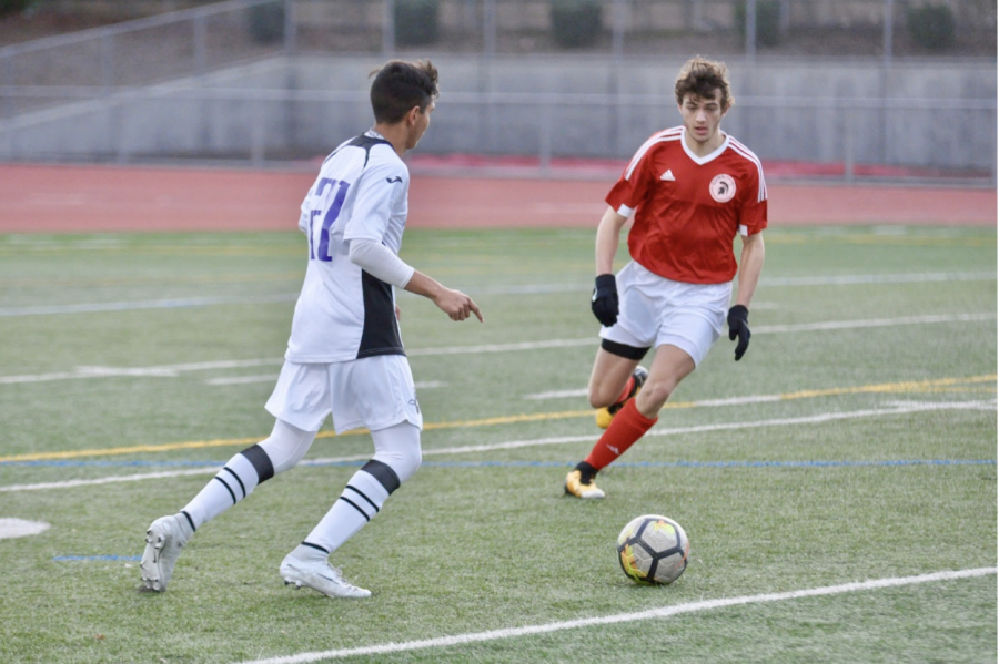 Senior Arjun Mathur dribbles in front of a GHS defender. GHS stopped MVHS from scoring any goals in this game.