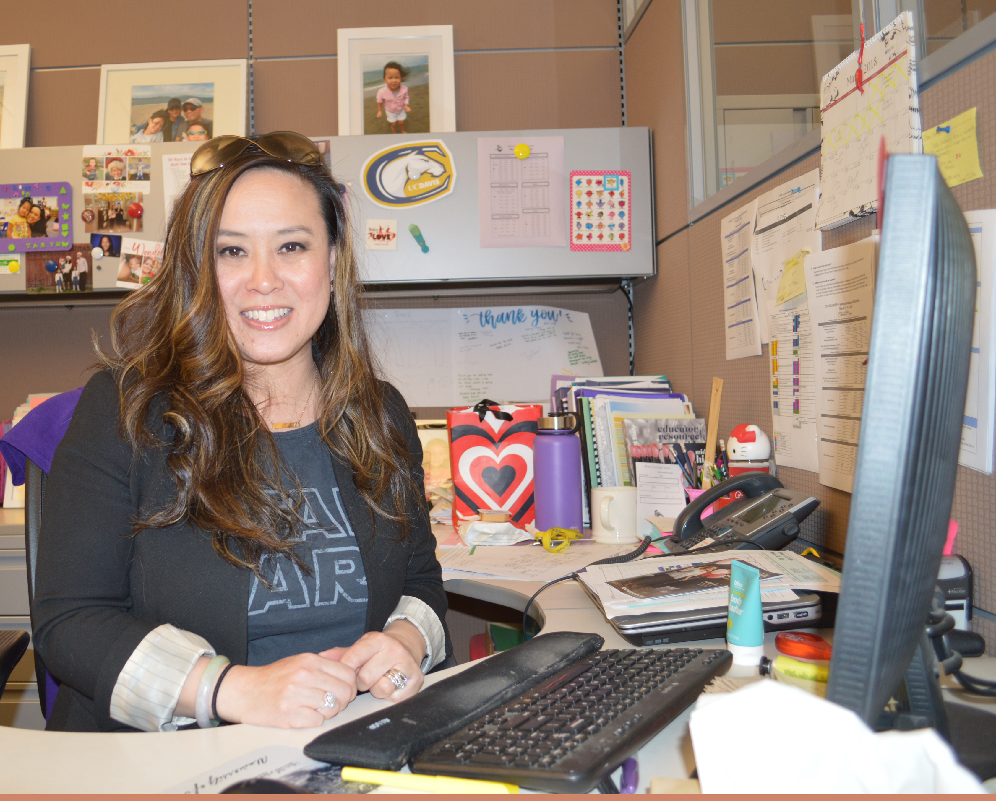 Lam poses at her desk in the MVHS guidance office. Lam was one of the winners of the 2018 Employee of the Year awards. Photo by Maggie McCormick.