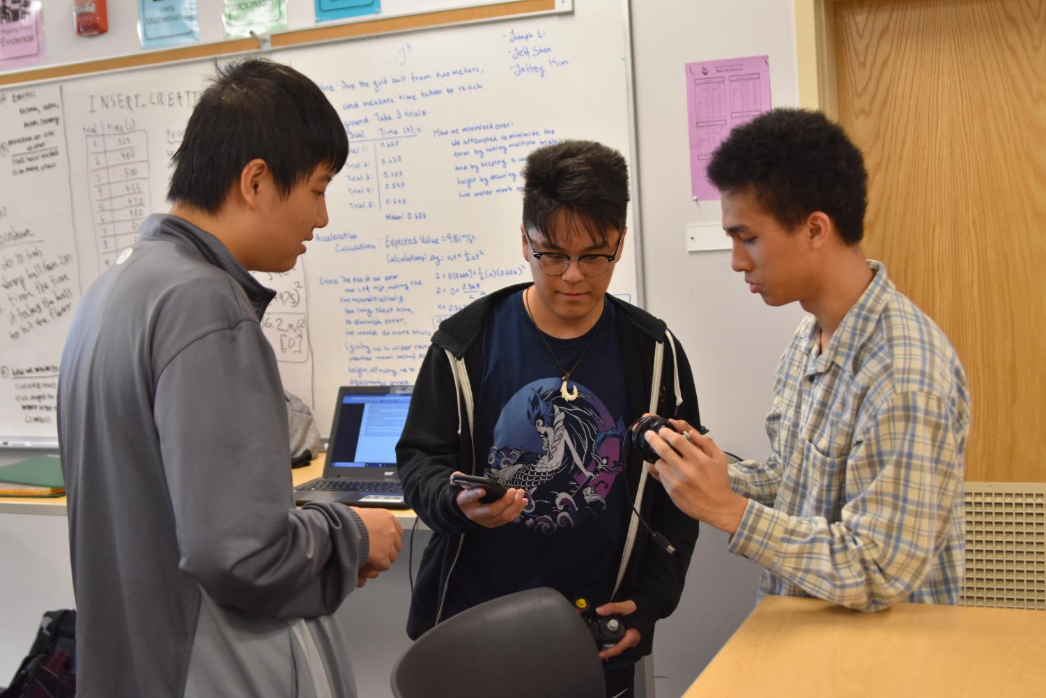 Seniors+Michael+Xiao%2C+Ethan+Yamada%2C+and+Spencer+Chang+%28left+to+right%29+discuss+the+setup+of+a+Smash+game.