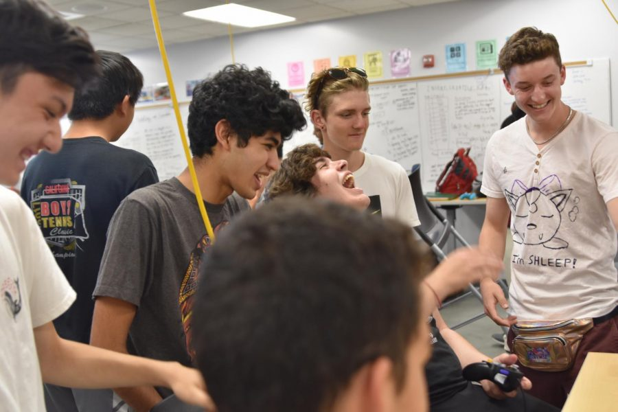 Senior Ethan Christian, juniors Yash Karandikar, Harry Neil and Dylan Frei and senior Bryce Nevitt (from left to right) share a laugh over a game of Smash.